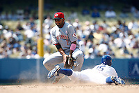 Alex Gonzalez of the Cincinnati Reds can't handle the throw as Rafael Furcal of the Los Angeles Dodgers slides into second base during a game in the 2007 MLB season game at Dodger Stadium in Los Angeles, California. (Larry Goren/Four Seam Images)