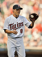 29 September 2012: Minnesota Twins infielder Jamey Carroll warms up prior to a game against the Detroit Tigers at Target Field in Minneapolis, MN. The Tigers defeated the Twins 6-4 in the second game of their 3-game series. Mandatory Credit: Ed Wolfstein Photo