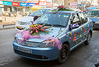India, Dehradun.  Car Decorated with Flowers for a Wedding.