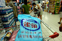 Nestle ice cream with a heat insulation bag on a shopping in a Carrefour supermarket in Beijing, China. Major international chains like Carrefour and Walmart Stores have expanded aggressively in China. Local Chinese retailers have loudly protested this and lobbied heavily for protection from the new competition in price and service that these major retailers have set off. 22 Jul 2006