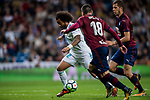 Marcelo Vieira Da Silva (l) of Real Madrid fights for the ball with Cristian Rivera Hernandez (r) and Anaitz Arbilla Zabala of SD Eibar during the La Liga 2017-18 match between Real Madrid and SD Eibar at Estadio Santiago Bernabeu on 22 October 2017 in Madrid, Spain. Photo by Diego Gonzalez / Power Sport Images