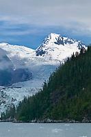 Chugach mountains visible through cloud layer over Meares glacier, Prince William Sound, Alaska