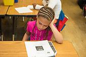 MR / Schenectady, New York. Yates Arts-in-Education Magnet School (urban public school). First grade classroom. Student (girl, 6, Hispanic American) taking test. MR: Car37. ID: AM-g1w. © Ellen B. Senisi.