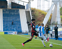 13th April 2021; The John Smiths Stadium, Huddersfield, Yorkshire, England; English Football League Championship Football, Huddersfield Town versus Bournemouth; Lloyd Kelly of Bournemouth blocks a clearance from Juninho Bacuna of Huddersfield Town