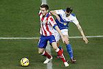 Atletico de Madrid's Saul Niguez (l) and UD Almeria's Fran Velez during La Liga match.February 21,2015. (ALTERPHOTOS/Acero)