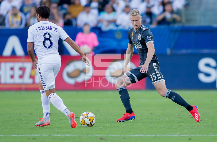 CARSON, CA - SEPTEMBER 29: Andy Rose #15 of the Vancouver Whitecaps moves to the ball during a game between Vancouver Whitecaps and Los Angeles Galaxy at Dignity Health Sports Park on September 29, 2019 in Carson, California.
