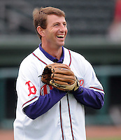 "April 13, 2009: Clemson head football coach Dabo Swinney warms up his throwing arm before Monday night's 2009 Drive opener. Swinney, who was to throw out the first pitch, said that Clemson football player C.J. Spiller had just sent him a text message, imploring him ""Don't pull your hamstring"" when throwing the ball. Photo by: Tom Priddy/Four Seam Images"