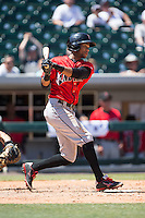 Pedro Florimon (17) of the Indianapolis Indians follows through on his swing against the Charlotte Knights at BB&T BallPark on June 21, 2015 in Charlotte, North Carolina.  The Knights defeated the Indians 13-1.  (Brian Westerholt/Four Seam Images)