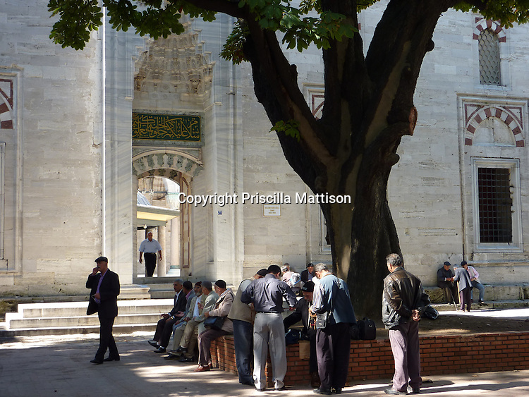 Istanbul, Turkey - September 23, 2009:  Men gather in front of the Bayezid II Mosque.