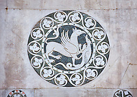 Late medieval inlay sculpture depicting a Griffin killing a mythical animal on the Facade of the Cattedrale di San Martino,  Duomo of Lucca, Tunscany, Italy,