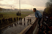 Berlin, Germany<br /> November 11, 1989<br /> <br /> East German police prepare a water canon to stop a group of West Germans as they break through the wall at the Brandenburg Gate. The East German government lifts travel and emigration restrictions to the West on November 9, 1989.