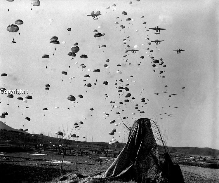 Paratroopers of the 187th RCT (Regimental Combat Team) float earthward from C-119's to cut off retreating enemy units south of Munsan, Korea.  March 23, 1951.  Cpl. P. T. Turner.  (Army)<br /> NARA FILE #:  111-SC-362121<br /> WAR & CONFLICT BOOK #:  1428