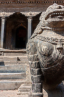 Nepal, Patan, Durbar Square. Mythical Tigers Guarding Entrance to the Krishna Mandir.