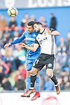 Francisco Portillo Soler of Getafe CF in action against Martin Montoya Torralbo of Valencia CF during the La Liga 2017-18 match between Getafe CF and Valencia CF at Coliseum Alfonso Perez on December 3 2017 in Getafe, Spain. Photo by Diego Gonzalez / Power Sport Images