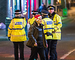 """© Joel Goodman - 07973 332324 . 15/12/2017. Manchester, UK. A man wearing a Santa hat and smoking a cigarette walks along Canal Street . Revellers out in Manchester City Centre overnight during """" Mad Friday """" , named for historically being one of the busiest nights of the year for the emergency services in the UK . Photo credit : Joel Goodman"""