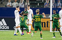 CARSON, CA - OCTOBER 07: Yimmi Chara #23 of the Portland Timbers  scores a goal and celebrates with Felipe Mora #9 and his Portland Timbers teammates during a game between Portland Timbers and Los Angeles Galaxy at Dignity Heath Sports Park on October 07, 2020 in Carson, California.