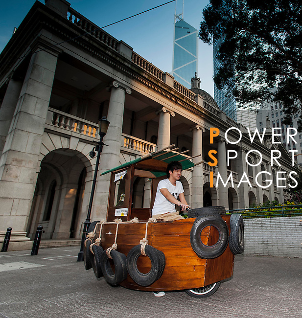 Competitors pose with their car creations ahead the Red Bull SoapBox on October 09, 2012 in Hong Kong's Central district. Photo by Xaume Olleros / The Power of Sport Images
