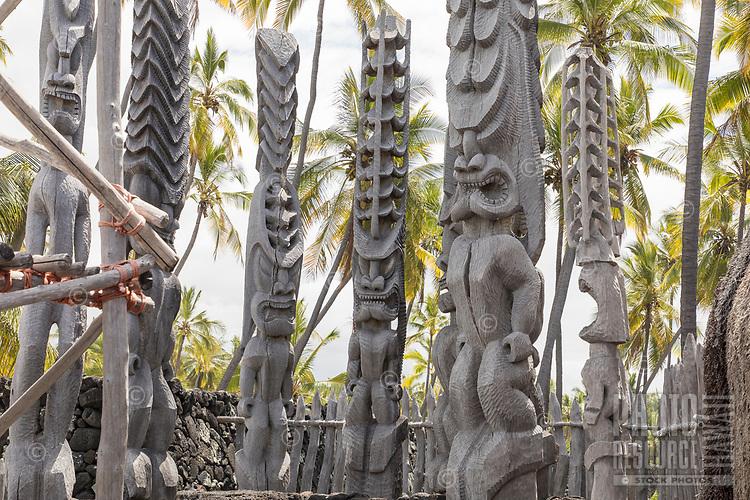 Ki'i or tiki (carved images) near a recreated heiau or temple at Pu'uhonua o Honaunau, Hawai'i Island.