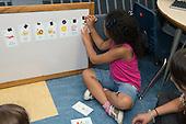 MR / Schenectady, NY. Zoller Elementary School (urban public school). Kindergarten classroom. Student (girl, 6, Hispanic-American) who is a native Spanish speaker reviews Spanish flashcards. MR: Fue3. ID: AM-gKw. © Ellen B. Senisi.