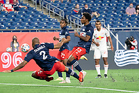 FOXBOROUGH, MA - MAY 22: Andrew Farrell #2 of New England Revolution intercepts a ball in the New England Revolution penalty box during a game between New York Red Bulls and New England Revolution at Gillette Stadium on May 22, 2021 in Foxborough, Massachusetts.