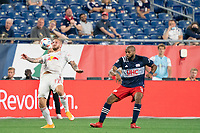 FOXBOROUGH, MA - MAY 22: Daniel Royer #77 of New York Red Bulls chest traps the ball during a game between New York Red Bulls and New England Revolution at Gillette Stadium on May 22, 2021 in Foxborough, Massachusetts.