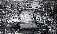 London: The Thames, looking east--aerial view, 1932, to Tower Bridge. From CITY AND RIVER.  Reference only.
