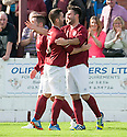 Linlithgow's Tommy Coyne (right) celebrates after he scores their winning second goal.