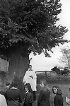The Wicken Love Feast, takes place on Ascension Day and celebrates the joining together of two parishes in 1587. Wicken Northamptonshire 1970s Uk.  Open air service under the Gospel Oak (Not sure here it may be an Elm) <br />