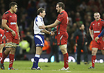 Wales captain Sam Warburton shakes hands with Referee Alain Rolland at the final whistle.<br /> RBS 6 Nations 2014<br /> Wales v France<br /> Millennium Stadium<br /> 21.02.14<br /> <br /> ©Steve Pope-SPORTINGWALES