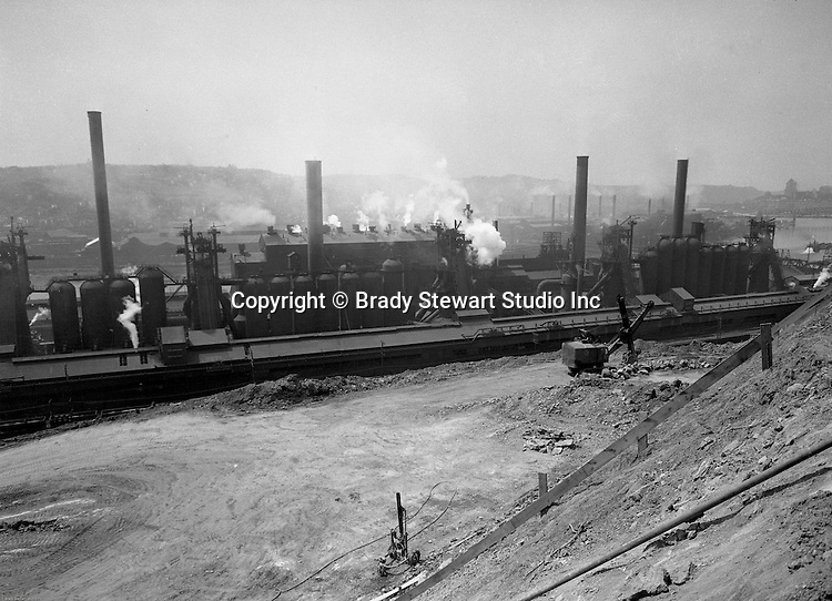 Pittsburgh PA:  View of the Jones and Laughlin's Steel Mill in Hazelwood right across the river for J&L's South Side works. <br /> Jones and Laughlin Steel began producing Steel in 1886.  They constructed one plant on the South Side and one plant across the river in Hazelwood.  The company built the Hot Metal Bridge to connect the plants.  They shipped raw materials (pig iron) from Hazelwood over to the blast furnaces on the South Side.<br /> J&L merged with Republic Steel in 1984 to form LTV Steel. The factories closed for good in 1997.