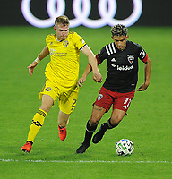 WASHINGTON, DC - OCTOBER 28: Yamil Asad #11 of D.C. United battles for the ball with Chris Cadden #2 of Columbus Crew SC during a game between Columbus Crew and D.C. United at Audi Field on October 28, 2020 in Washington, DC.