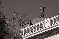 """A copper dome with clocks on each side sits in the center of the roof (Georgetown Courthouse) with a blindfolded statue of Themis on top, holding scales and a sword. Themis is described as """"of good counsel"""", and is the embodiment of divine order, law, and custom."""