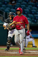 Palm Beach Cardinals Roblin Heredia (29) flips his bat after an at bat during a game against the Jupiter Hammerheads on May 11, 2021 at Roger Dean Chevrolet Stadium in Jupiter, Florida.  (Mike Janes/Four Seam Images)