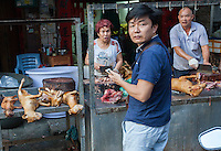 Dogs are seen for sale in Yulin during the Yulin Dog Meat Festival, Yulin, Guangxi Province, China, 21 June 2016.<br /> <br /> Photo by STR / Sinopix