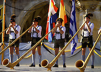 Traditional alpenhorn band musicians in leiderhosen play during Oktoberfest celebrations. Munich, Germany.