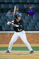 Garrett Kelly (28) of the Wake Forest Demon Deacons at bat against the Missouri Tigers at Wake Forest Baseball Park on February 22, 2014 in Winston-Salem, North Carolina.  The Demon Deacons defeated the Tigers 1-0.  (Brian Westerholt/Four Seam Images)
