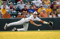 Texas Longhorn third baseman Erich Weiss #6 dives for a ground ball against the Arizona State Sun Devils  in NCAA Tournament Super Regional Game #3 on June 12, 2011 at Disch Falk Field in Austin, Texas. (Photo by Andrew Woolley / Four Seam Images)