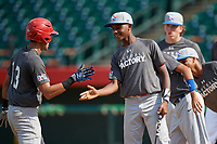 Jeffrey Diaz (13) high fives Yasel De Los Santos (12) after hitting a home run during the Dominican Prospect League Elite Underclass International Series, powered by Baseball Factory, on August 31, 2017 at Silver Cross Field in Joliet, Illinois.  (Mike Janes/Four Seam Images)