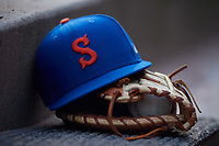 Syracuse Mets hat and glove during an International League game against the Buffalo Bisons on June 29, 2019 at Sahlen Field in Buffalo, New York.  Buffalo defeated Syracuse 9-3.  (Mike Janes/Four Seam Images)