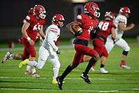 Farmington's Devonte Donovan (4) carries the ball Friday, Oct. 16, 2020, through the Clarksville defense during the first half of play at Cardinal Stadium in Farmington. Visit nwaonline.com/201017Daily/ for today's photo gallery. <br /> (NWA Democrat-Gazette/Andy Shupe)