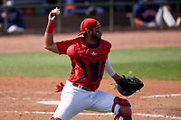 St. Louis Cardinals catcher Dennis Ortega (73) throws down to second base during a Major League Spring Training game against the Houston Astros on March 20, 2021 at Roger Dean Stadium in Jupiter, Florida.  (Mike Janes/Four Seam Images)