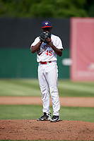 Auburn Doubledays relief pitcher Jose De Los Santos (45) looks in for the sign during a game against the Batavia Muckdogs on June 17, 2018 at Falcon Park in Auburn, New York.  Auburn defeated Batavia 10-8.  (Mike Janes/Four Seam Images)