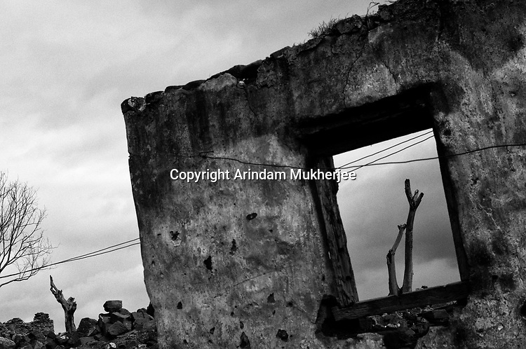 A wall of a coal mine fire destroyed house at Jharia, Jharkhand, India