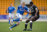St Johnstone v Hibs...22.03.14    SPFL<br /> David Wotherspoon and Daniel Boateng<br /> Picture by Graeme Hart.<br /> Copyright Perthshire Picture Agency<br /> Tel: 01738 623350  Mobile: 07990 594431