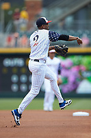 Charlotte Knights shortstop Alcides Escobar (2) makes a throw to first base against the Durham Bulls at BB&T BallPark on May 27, 2019 in Charlotte, North Carolina. The Bulls defeated the Knights 10-0. (Brian Westerholt/Four Seam Images)