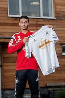 Thursday 22 January 2015<br /> Pictured: Kyle Naughton holds a Swansea City shirt after signing for the Swans <br /> Re: Kyle Naughton Signs for Swansea City FC from Spurs