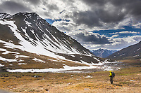 Backpacker and Itkillik river in the Brooks Range, Gates of the Arctic National Park, Alaska.