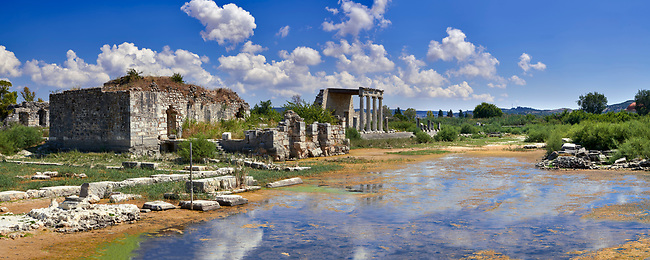 The Roman Ionic Stoa forms a colonnade 99 m long & 9 m high at the beginning of the Sacred Way to Didyma. An Ionic portica at its centre which served as a grandstand during ceremonial processions on the street in front of it. 1st century AD, Miletus Archaeological Site, Anatolia, Turkey.
