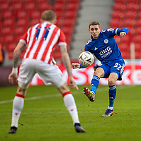 9th January 2021; Bet365 Stadium, Stoke, Staffordshire, England; English FA Cup Football, Carabao Cup, Stoke City versus Leicester City; Timothy Castagne of Leicester City passes the ball past James McClean of Stoke City