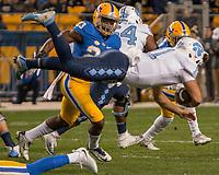 North Carolina quarterback Nathan Elliott (11) dives with the ball. The North Carolina Tarheels defeated the Pitt Panthers football team 34-31 at Heinz Field, Pittsburgh, Pennsylvania on November 9, 2017.